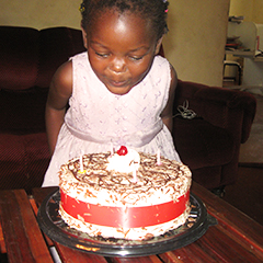 zimbabwean girl blowing out birthday candles