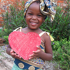 zimbabwean girl with a paper heart