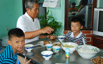 Vietnamese father with sons