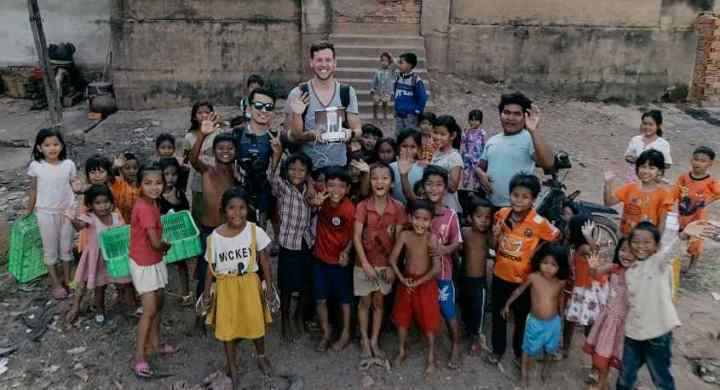 Tyler and Alex with children in Cambodia